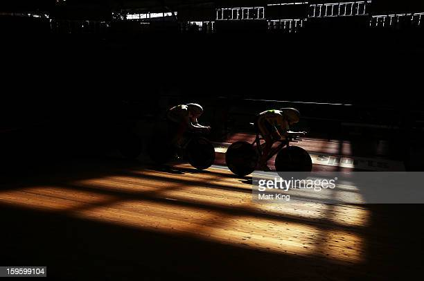 Members of the Australian Gold team compete in the Men's U19 Team Sprint Final during day two of the 2013 Australian Youth Olympic Festival at Dunc...