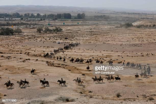 Members of the Australian Light Horse association ride horses on October 29 2017 near BeerSheva on the northern Israeli desert during a reenactment...