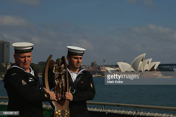 Members of the Australian Navy carry the NRL premiership trophy on deck during the 2013 NRL Finals Captain's Call aboard the HMAS Leeuwin at the...