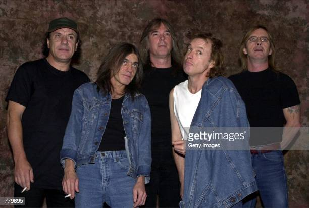 Members of the Australian rock band ACDC pose for a photograph after the Rock Walk handprint ceremony September 15 2000 at the Guitar Center in...