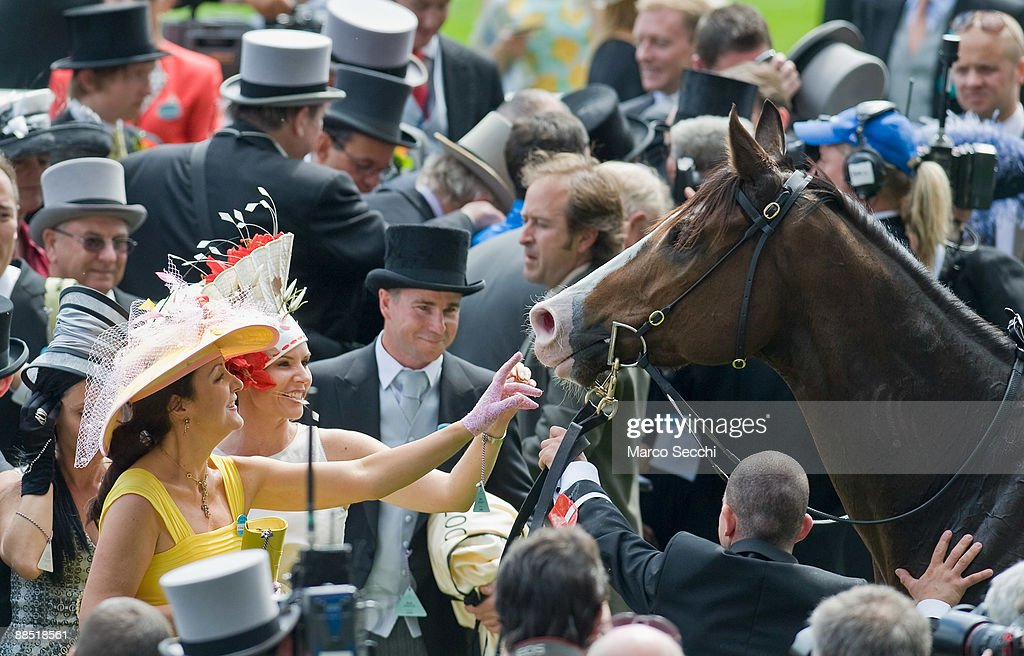 Members of the Australian syndicate that owns Scenic Blast celebrate their victory in The King's Stand Stake on the first day of Royal Ascot 2009 at Ascot Racecourse