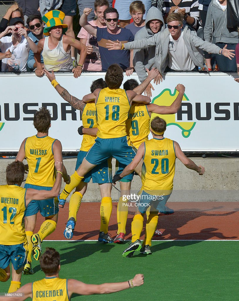 Members of the Australian team run to fans after scoring a golden goal in the gold medal match against the Netherlands at the men's Hockey Champions Trophy tournament in Melbourne on December 9, 2012. Australia won the match 2-1 in extra time. IMAGE STRICTLY RESTRICTED TO EDITORIAL USE - STRICTLY NO COMMERCIAL USE AFP PHOTO/Paul CROCK