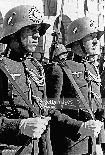 Members of the Austrian Heimwehr wear the swastika as their army is inducted en masse into the German Wehrmacht