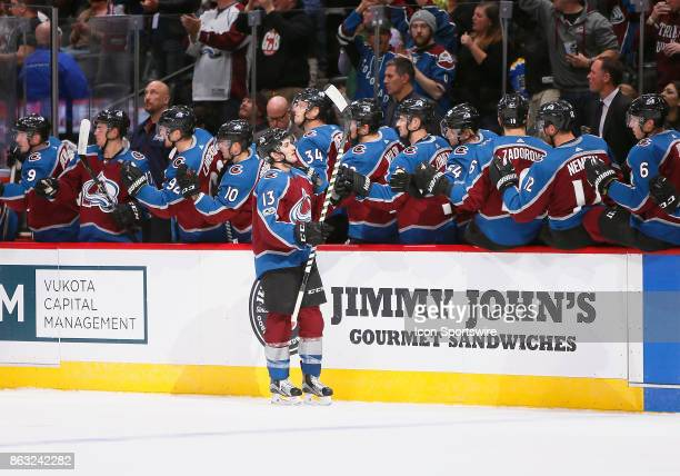 Members of the Avalanche bench congratulate Colorado Avalanche center Alexander Kerfoot following a first period goal during a regular season game...