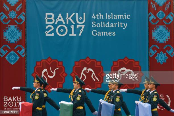Members of the Azerbaijani Army carry flags ahead of the Women's Freestyle 69kg Wrestling medals ceremony during Baku 2017 4th Islamic Solidarity...