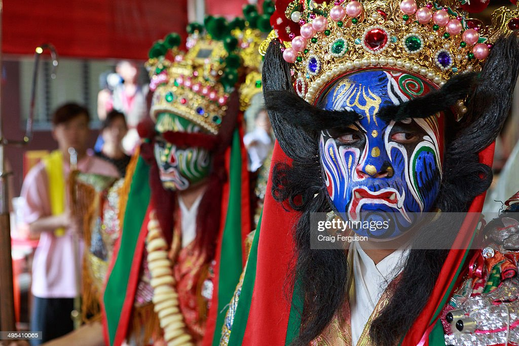 Members of the ba jia jiang temple guardians at Xiahai Temple during celebrations for the Taipei City God festival.
