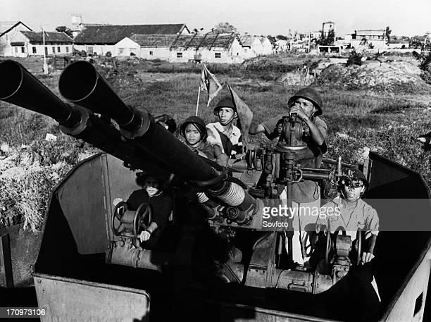 Members of the bach dang shipyards militia with their antiaircraft gun defending their workplace against american air attack north vietnam 1969