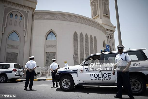 Members of the Bahraini security forces man a checkpoint outside a Shiite Mosque ahead of Friday prayers in the village of Ras Ruman on the outskirts...