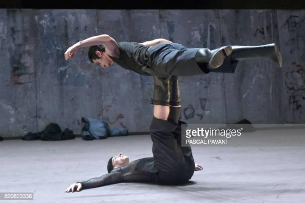 Members of the Ballet du Capitole in Toulouse dance on April 13 2016 in the Auditorium SaintPierre des Cuisines in Toulouse part of a new show...