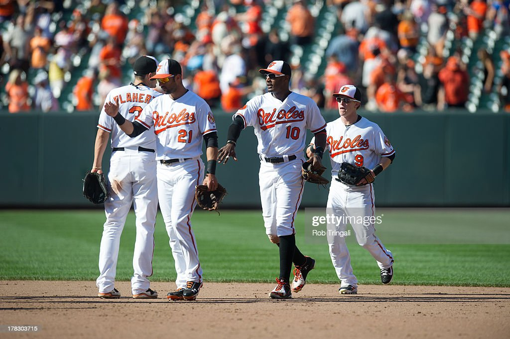Members of the Baltimore Orioles celebrate their victory over the Oakland Athletics on Sunday, August 25, 2013 at Oriole Park in Baltimore, Maryland.