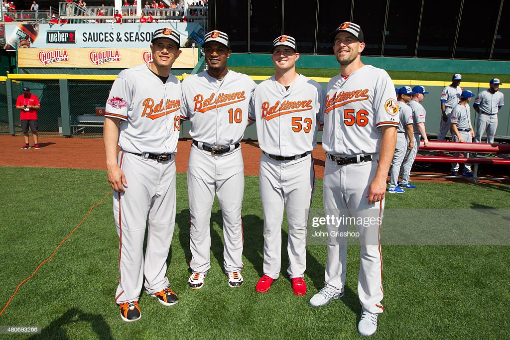 Members of the Baltimore Orioles pose for a photo on the field before the 86th MLB AllStar Game at Great American Ball Park in Cincinnati on Tuesday...