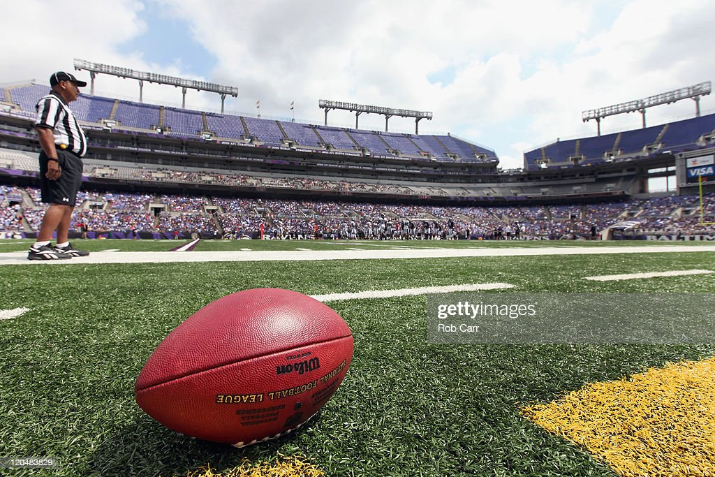 Members of the Baltimore Ravens scrimmage during training camp at MT Bank Stadium on August 6 2011 in Baltimore Maryland