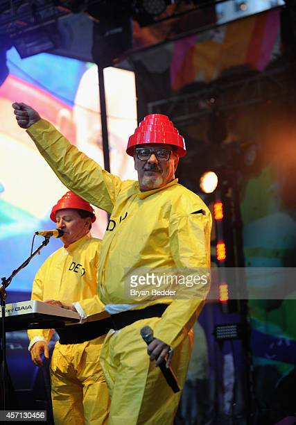 Members of the band Devo Gerald Casale and Mark Mothersbaugh perform during CBGB Music Film Festival 2014 Times Square Concerts on October 12 2014 in...