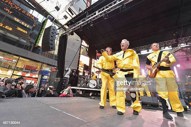 Members of the band Devo Gerald Casale Mark Mothersbaugh Bob Mothersbaugh performs during CBGB Music Film Festival 2014 Times Square Concerts on...