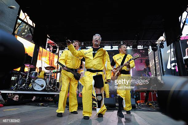 Members of the band Devo Gerald Casale Mark Mothersbaugh Bob Mothersbaugh perform during CBGB Music Film Festival 2014 Times Square Concerts on...