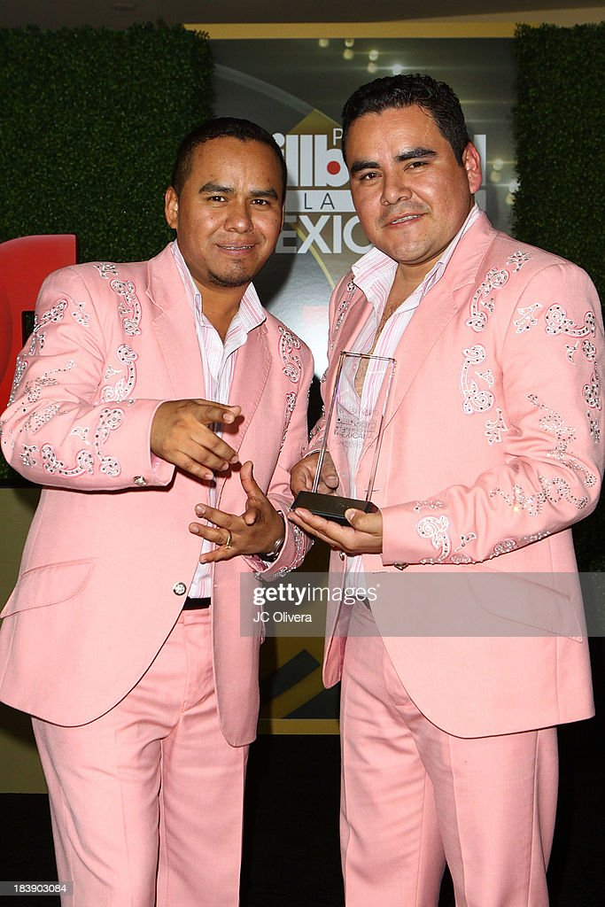Members of the Band El Trono De Mexico pose for a photograph at The 2013 Billboard Mexican Music Awards - Press Room at Dolby Theatre on October 9, 2013 in Hollywood, California.
