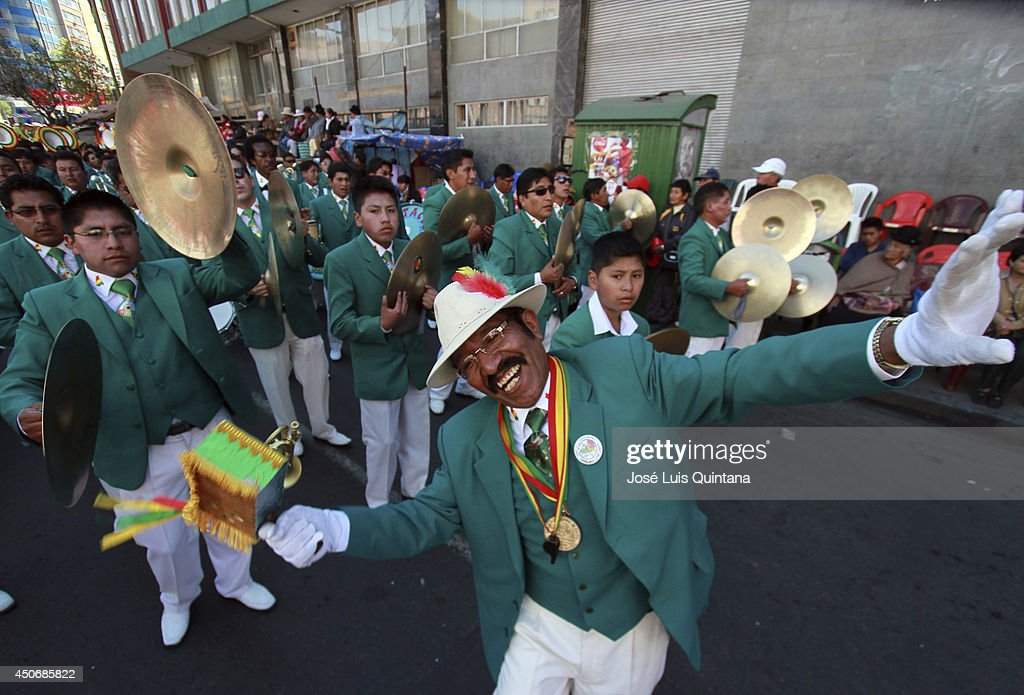 Members of the band 'Espectacular de Bolivia' dance during the religious festival of Jesus del Gran Poder on June 15, 2014 in La Paz, Bolivia. About thirty thousand people attended the event, which is a traditional folk celebration in the country.
