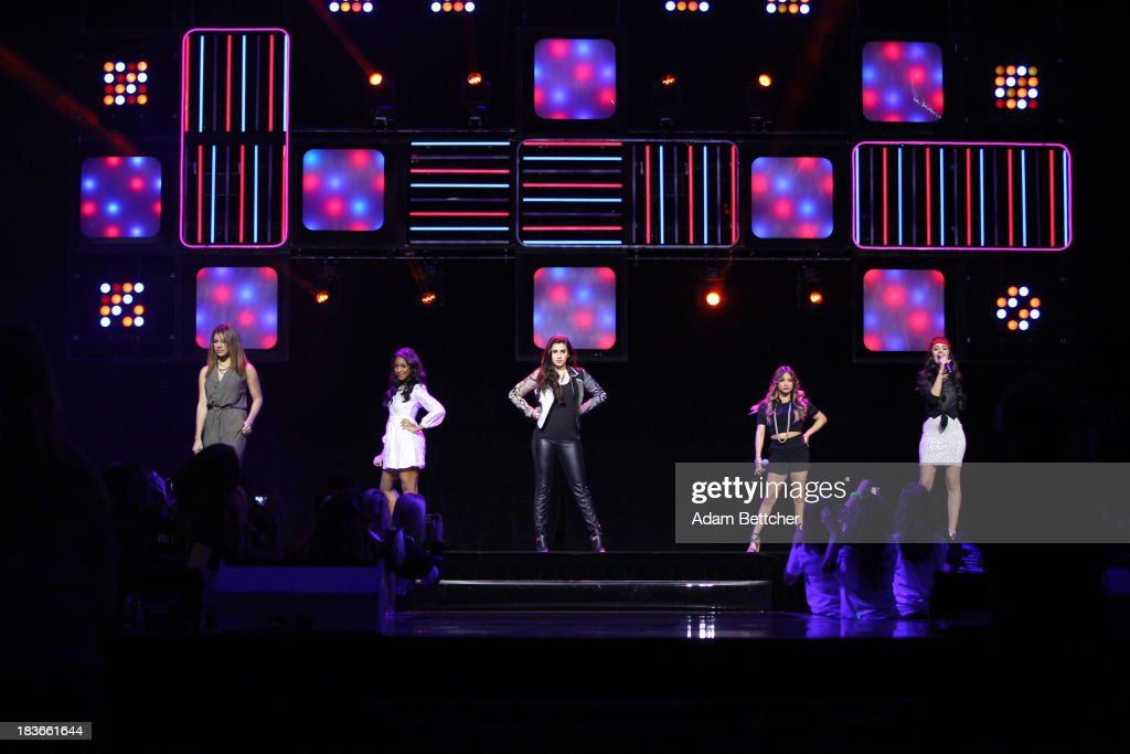 Members of the band Fifth Harmony perform during the We Day Minnesota event at the Xcel Energy Center in St. Paul, Minnesota on October 8, 2013