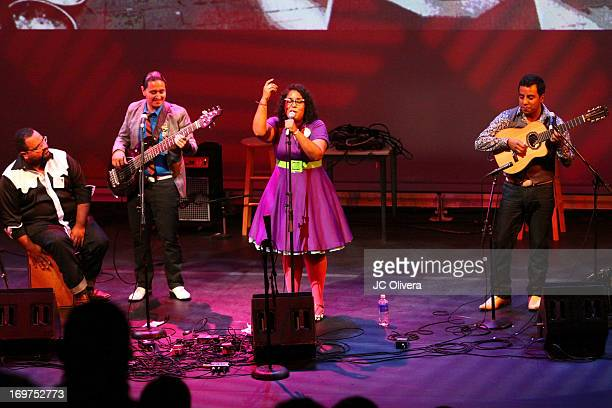 Members of the band La Santa Cecilia perform on stage during Sonic Overdrive Songs and Stories through the streets of Los Angeles at J Paul Getty...