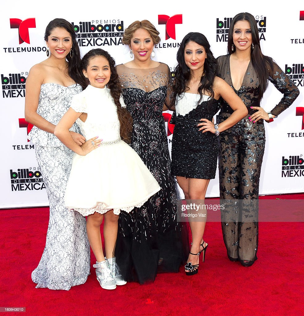 Members of the band Las Fenix attend the 2013 Billboard Mexican Music Awards arrivals at Dolby Theatre on October 9, 2013 in Hollywood, California.