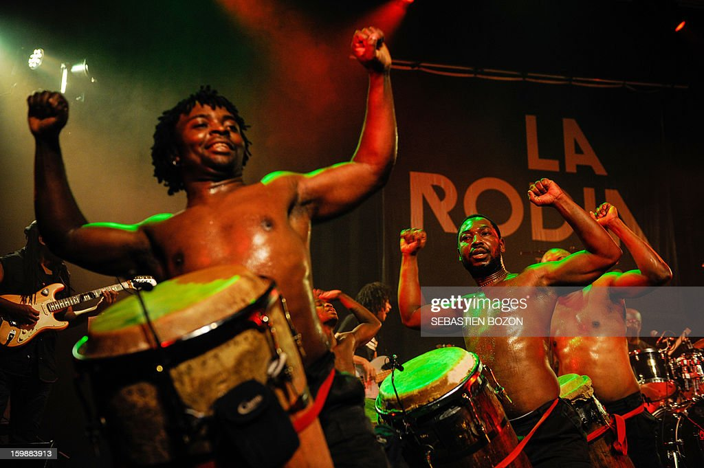 Members of the band 'Les tambours de Brazza' perform on stage at La Rodia on January 18, 2013, in Besancon.