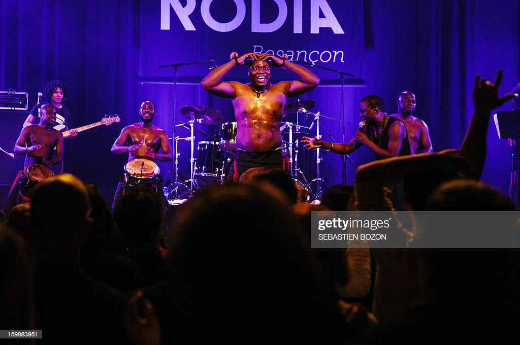 Members of the band 'Les tambours de Brazza' perform on stage at La Rodia on January 18, 2013, in Besancon. AFP PHOTO / SEBASTIEN BOZON