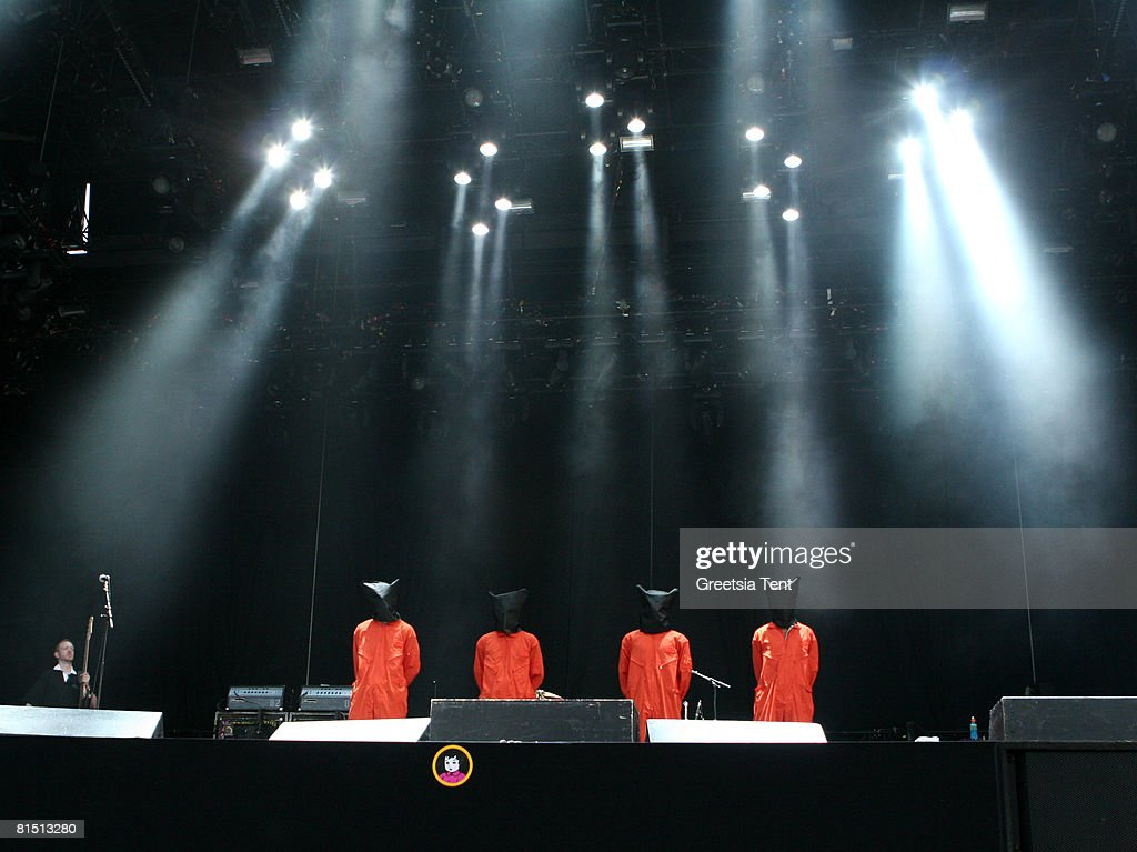 Members of the band Rage Against The Machine (LtoR: Tim Commeford, Brad Wilk, Zack de la Roche and Tom Morello) dress up as Guantanamo Bay prisoners, in orange jumpsuits and black hoods in protest to the US Government, while performing the song 'Bombtrack' live on day 3 of the 39th Pinkpop Festival on June 1, 2008 in Landgraaf, Netherlands.