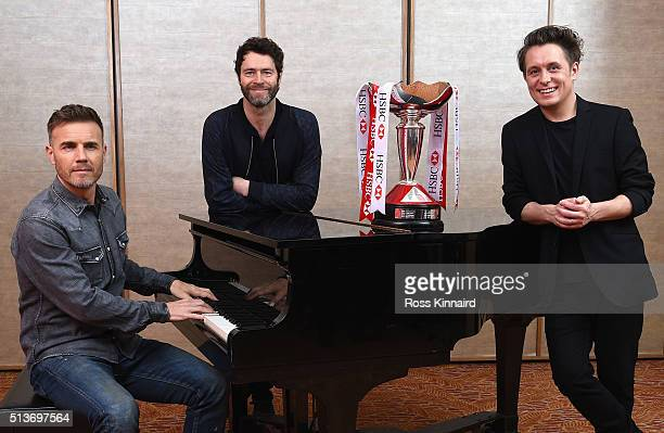 Members of the band Take That Gary Barlow Howard Donald and Mark Owen pose for a photograph prior to tomorrow's Take That concert at the HSBC Women's...