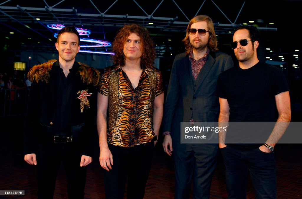 Members of the band <a gi-track='captionPersonalityLinkClicked' href=/galleries/search?phrase=The+Killers+-+Band&family=editorial&specificpeople=3954390 ng-click='$event.stopPropagation()'>The Killers</a>, Brandon Flowers, Dave Keuning, <a gi-track='captionPersonalityLinkClicked' href=/galleries/search?phrase=Mark+Stoermer&family=editorial&specificpeople=234409 ng-click='$event.stopPropagation()'>Mark Stoermer</a>, and <a gi-track='captionPersonalityLinkClicked' href=/galleries/search?phrase=Ronnie+Vannucci&family=editorial&specificpeople=228165 ng-click='$event.stopPropagation()'>Ronnie Vannucci</a> Jr arrive at the Vodafone MTV Australia Awards 2009 at the Sydney Convention and Exhibition Centre, Darling Harbour on March 27, 2009 in Sydney, Australia.