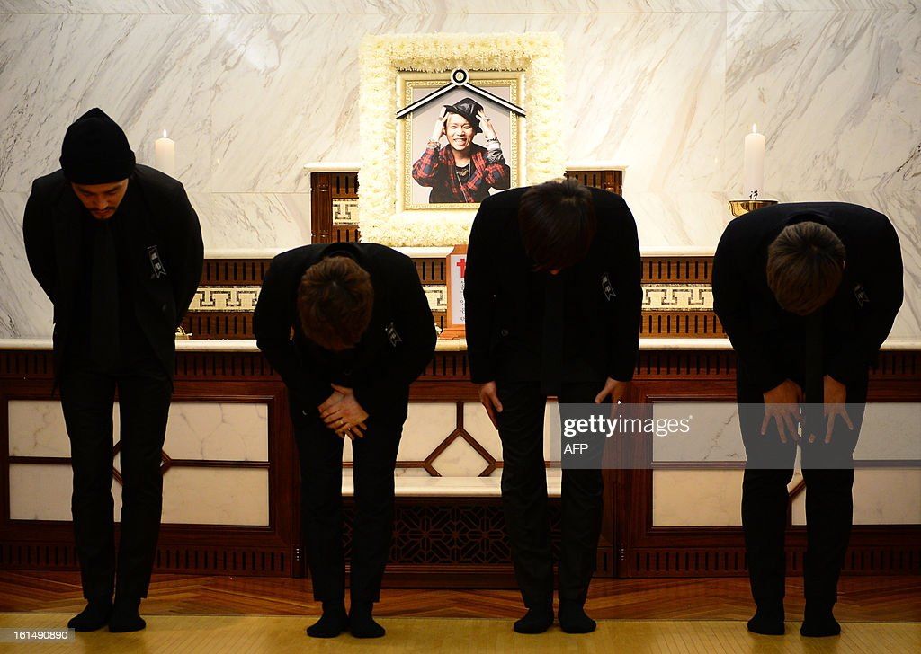 Members of the band Ulala Session bow to mourners at the funeral for their band member Lim Yoon-Taek (in photo, C) in Seoul on February 12, 2013. Lim, the leader of the South Korean band Ulala Session died on February 11 from stomach cancer. REPUBLIC