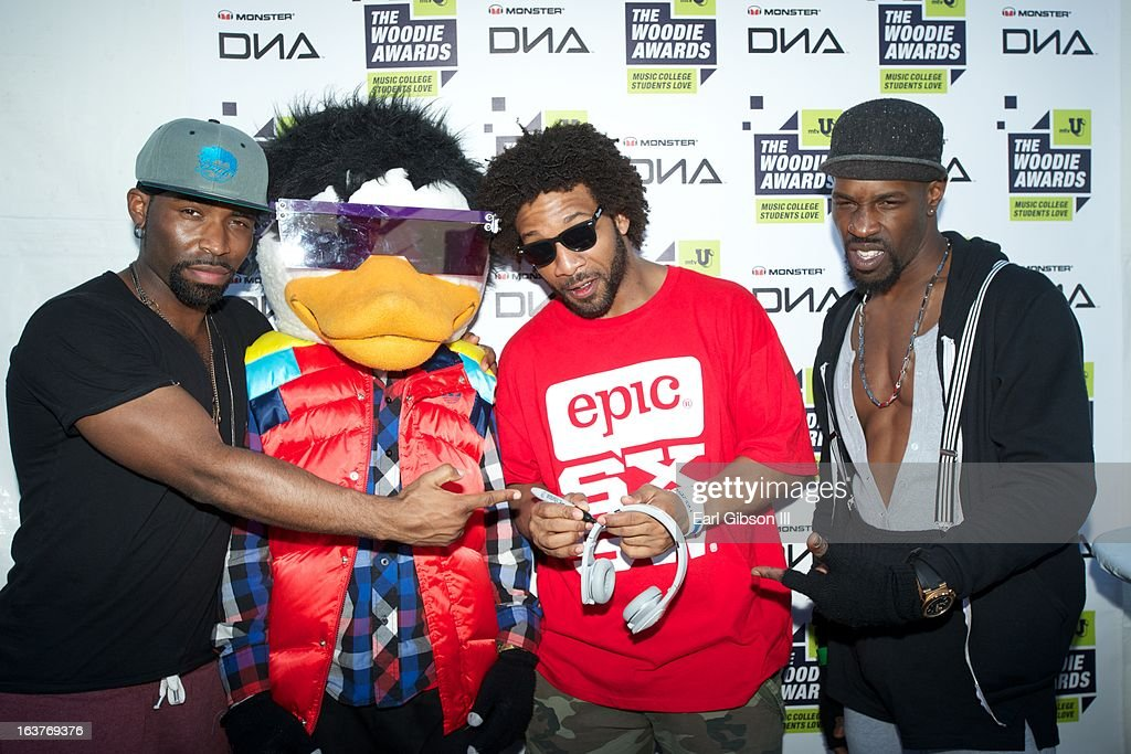 Members of the band Watch the Duck pose for a photo while signing a pair of DNA Monsteheadphones backstage at the mtvU Woodie Awards on March 14, 2013 in Austin, Texas.