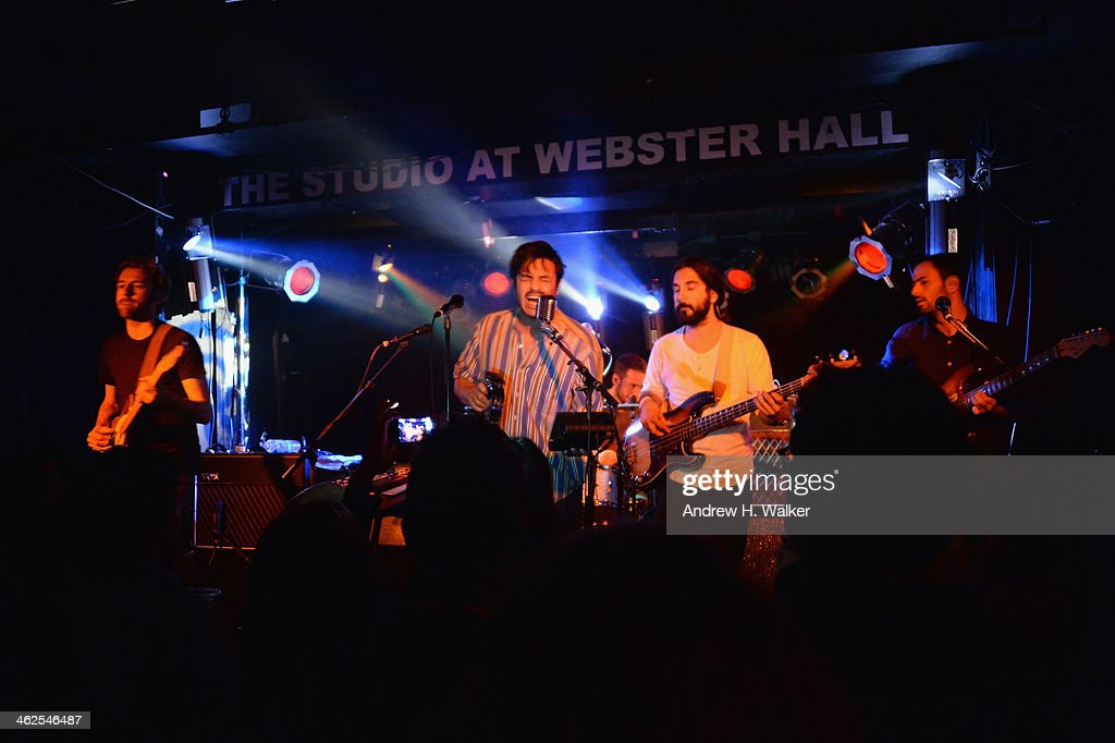 Members of the band Young The Giant, Sameer Gadhia (lead vocals), Jacob Tilley (guitar), Eric Cannata (guitar), Payam Doostzadeh (bass guitar) and Francois Comtois (drums) perform during a private concert for SiriusXM listener to air live on SiriusXM's Alt Nation at The Studio At Webster Hall on January 13, 2014 in New York City.
