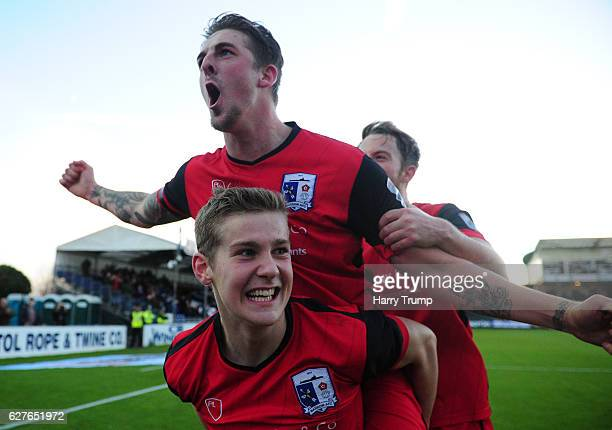 Members of the Barrow FC side celebrate victory during the Emirates FA Cup Second Round match between Bristol Rovers and Barrow FC at the Memorial...