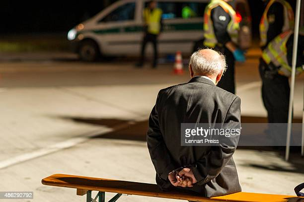 Members of the Bavarian police arrest a man on the suspicion of smuggling migrants from Austria into Germany in the early hours on the A3 highway on...
