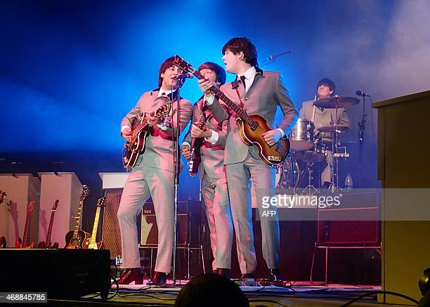 Members of the Beatles tribute band Beatlemania Now perform at the old Washington Coliseum on February 11 50 years to the day that the Fab Four...