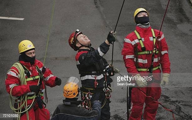 Members of the Berlin city fire department secure ropes during an emergency rescue drill from the 368m tall broadcasting tower at Alexander Platz...