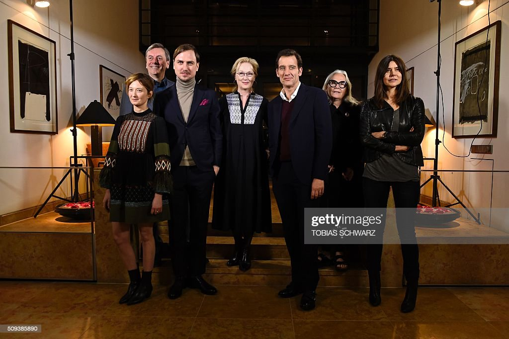 Members of the Berlinale film festival jury, Italian actress Alba Rohrwacher, British film critic Nick James, German actor Lars Eidinger, US actress and jury president Meryl Streep, British actor Clive Owen, French photographer Brigitte Lacombe and Polish film maker Ma?gorzata Szumowska pose for photographers on the eve of the opening of the Berlinale film festival in Berlin on February 10, 2016. / AFP / TOBIAS SCHWARZ