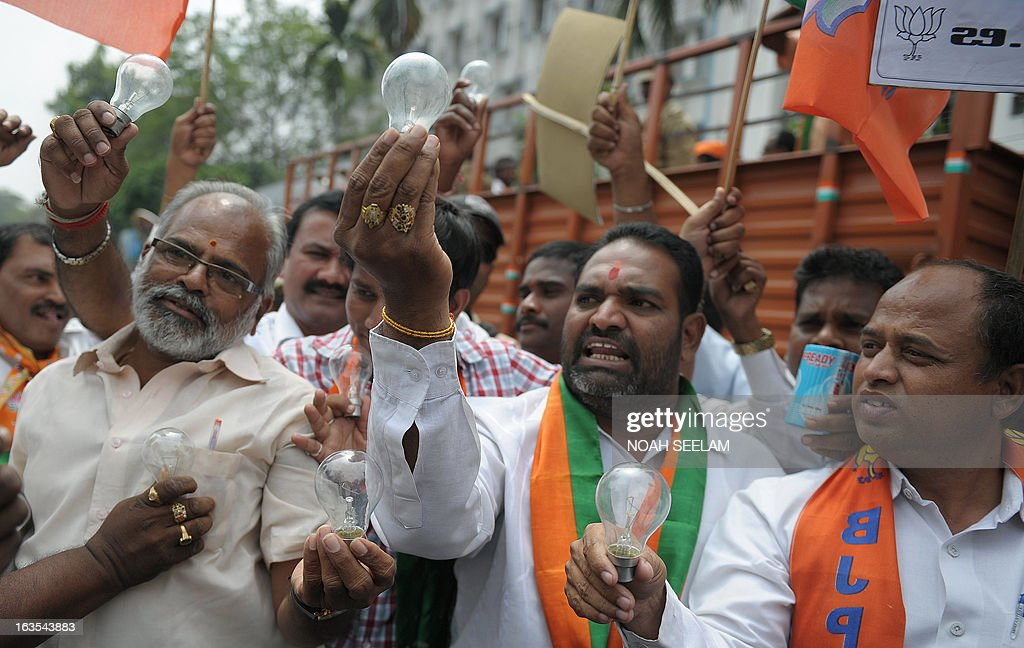 Members of the Bharatiya Janata Party (BJP) hold up lightbulbs during a protest against power cuts in Hyderabad on March 12, 2013. The opposition party organised state wide protests in support of their demand for providing uninterrupted power supply in the interests of the common people and farmers of the State of Andhra Pradesh. AFP PHOTO / Noah SEELAM