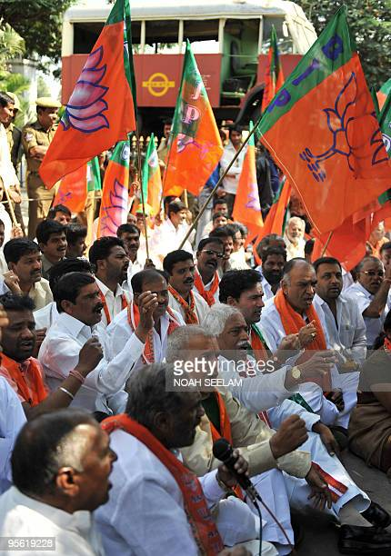 Members of the Bharatiya Janata Party shout slogans against the state governement during their protest against busfare hikes in Hyderabad on January...