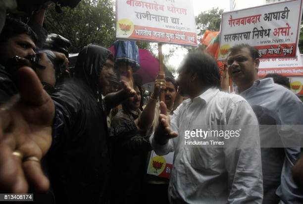 Members of the BJP Youth wing protest at Teenbatti near education minister Balasaheb Thorat's house on Friday after the High Court scrapped the...