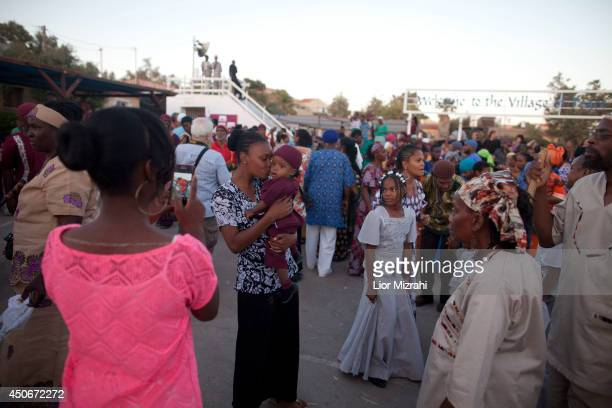 Members of the Black Hebrews community are seen during the celebration of Shavuot harvest festival on June 15 2014 in Dimona Israel The community who...