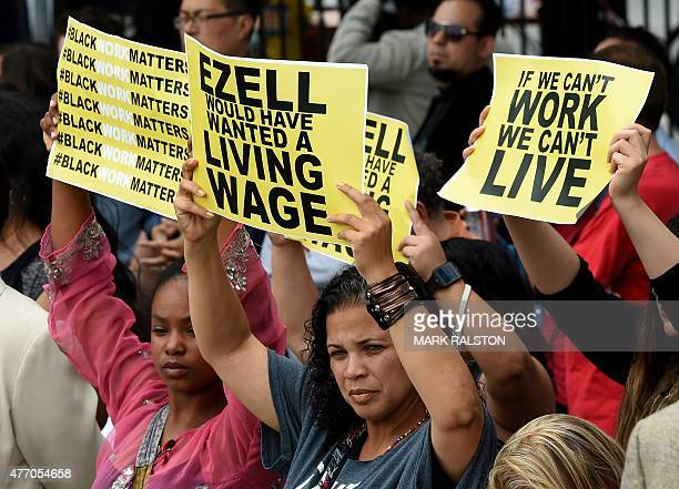 Members of the 'Black Lives Matter' group protest the death of Ezell Ford as the Los Angeles Mayor Eric Garcetti signs into law an ordinance raising...