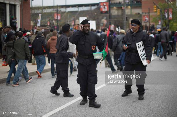 Members of the Black Panther Party walk away from a protest area as demonstrators protest the death Freddie Gray an African American man who died of...