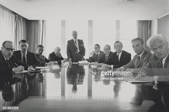Members of the board all turn to face the camera during a board meeting 1993