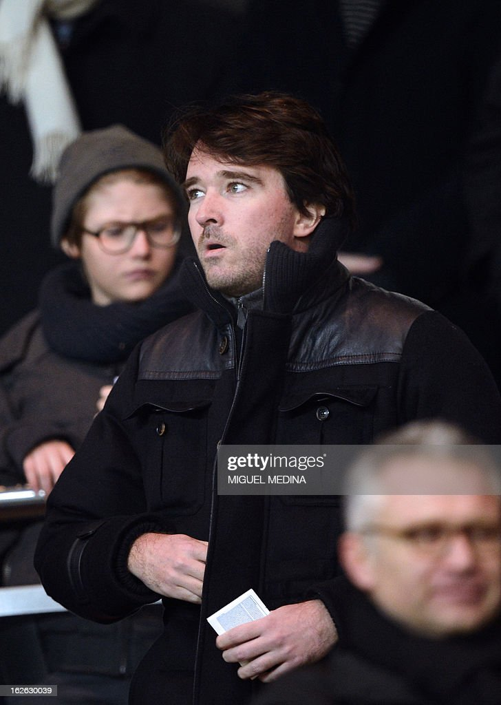 LVMH members of the board of directors Antoine Arnault is pictured in the stands during the French L1 football match Paris Saint-Germain (PSG) vs Olympique de Marseille (OM) on February 24, 2013 at the Parc des Princes stadium in Paris. AFP PHOTO MIGUEL MEDINA