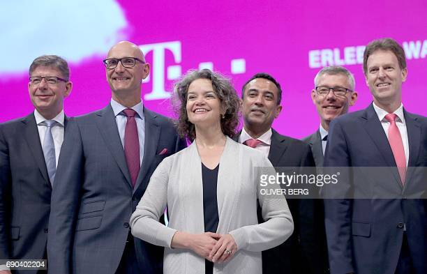 Members of the board of German telecommunications giant Deutsche Telekom pose during their company's annual general meeting in Cologne western...