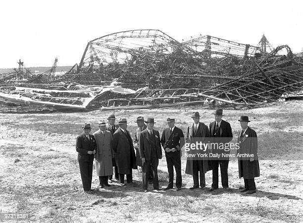 Members of the Board of Inquiry for the Department of Commerce look over ruins of the Hindenburg at Lakehurst as probe into the dirigible's explosion...