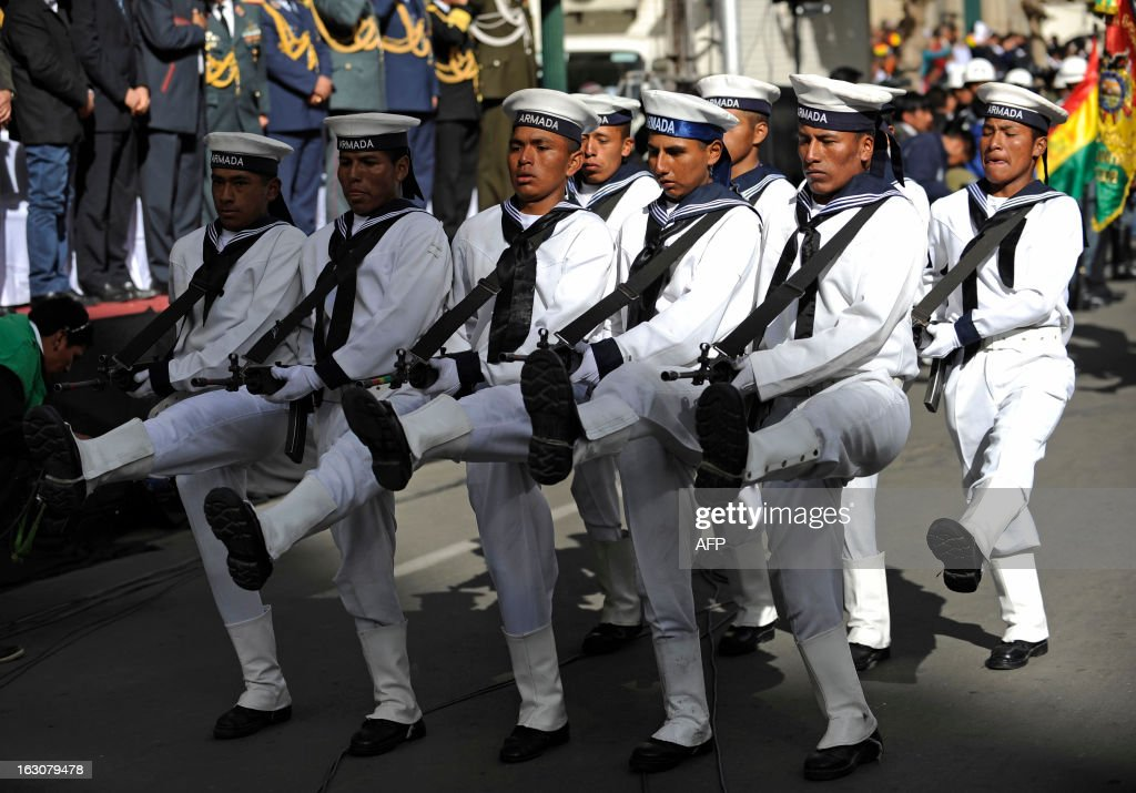Members of the Bolivian Navy take part in a parade for the decoration, by Bolivian President Evo Morales, of soldiers Augusto Cardenas, Alex Choque and Jose Luis Fernandez (the three out of frame), who were arrested over a month ago in Chile after illegaly trespassing the border whilst in pursuit of car smugglers, in front of the presidential palace Quemado in La Paz, on March 4, 2013. The three Bolivian soldiers, whose arrest in January had heightened the tense relations between the two South American neighbours, where welcomed in their country last week with military honours.