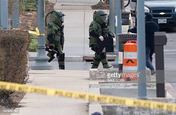 Members of the Bomb Squad work near the area of a suspicious package outside the Capitol South Metro Station near the US Capitol in Washington DC...