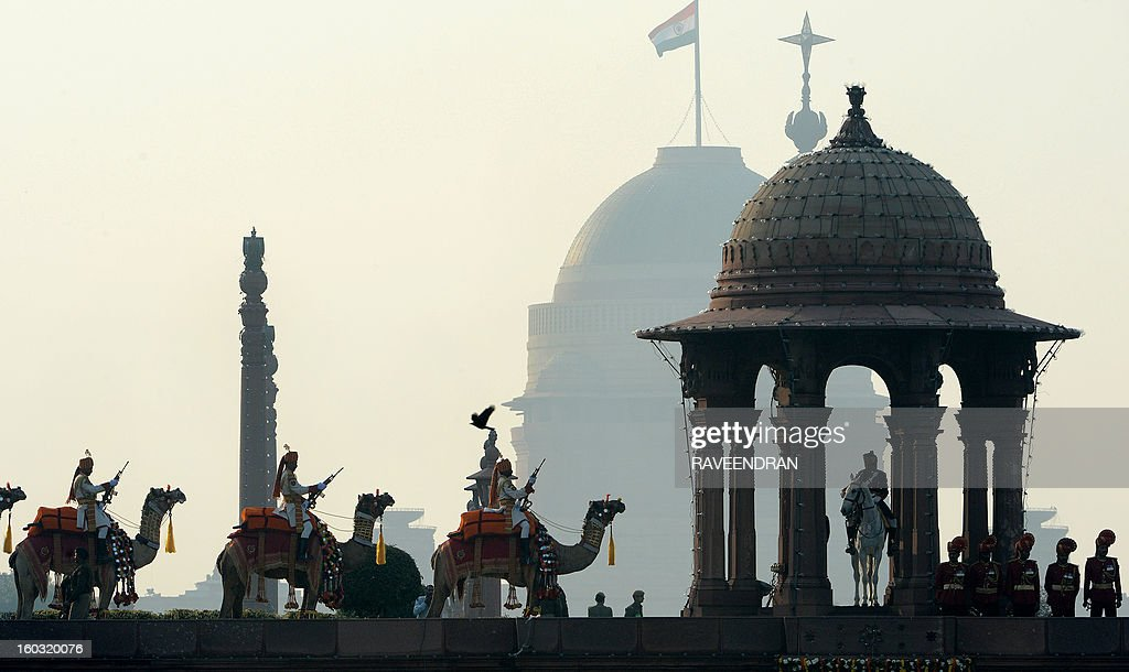 Members of the Border Security Force (BSF) stand guard on camels at the Secretariat and Parliament buildings during the Beating Retreat Ceremony at Vijay Chowk in New Delhi on January 29, 2013. The ceremony is a culmination of Republic Day celebrations and dates back to the days when troops disengaged themselves from battle at sunset.